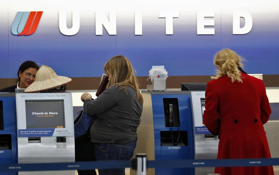 A United Airlines customer service representative helped passengers to reschedule their travel plans at O'Hare International Airport in Chicago in 2011.