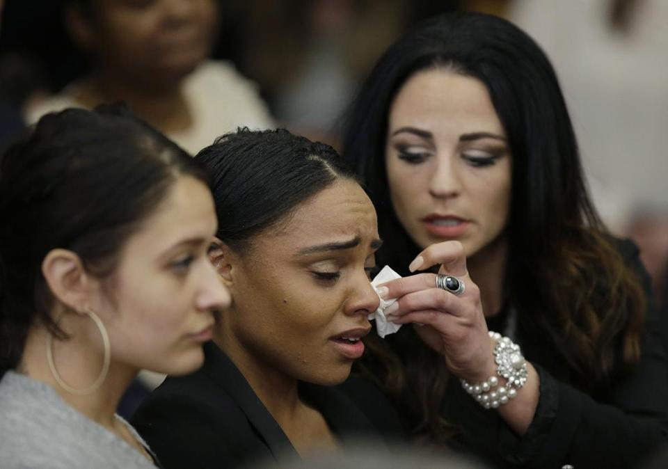 Shayanna Jenkins Hernandez, center, the fiancee of former New England Patriots tight end Aaron Hernandez, is comforted as she reacts to Hernandez's double murder acquittal Friday.