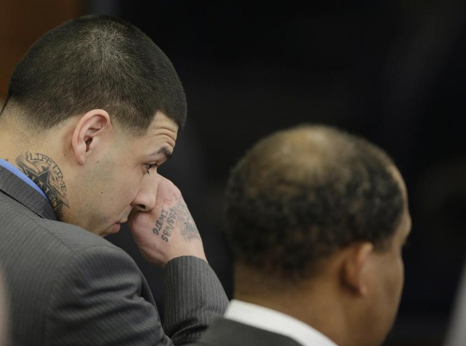 Aaron Hernandez wiped tears from his eyes as he reacted to his double murder acquittal. Hernandez stood trial for the July 2012 killings of Daniel de Abreu and Safiro Furtado who he encountered in a Boston nightclub.