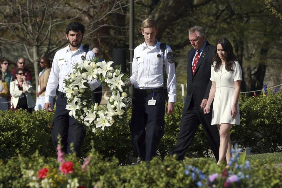 Governor Terry McAuliffe (second from right) and his daughter Dori helped present a wreath in Blacksburg, Va., Sunday.
