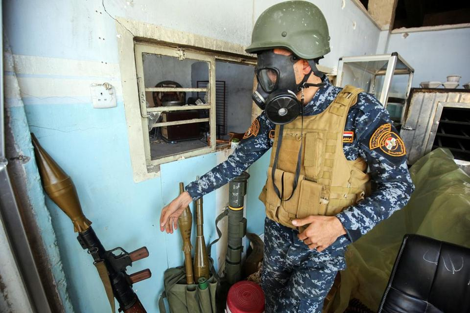 A member of the Iraqi forces wore a gas mask on Sunday during operations to recapture western Mosul.