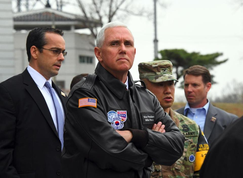 TOPSHOT - US Vice President Mike Pence (C) visits the truce village of Panmunjom in the Demilitarized Zone (DMZ) on the border between North and South Korea on April 17, 2017. Pence arrived at the gateway to the Demilitarized Zone dividing the two Koreas on on April 17, in a show of US resolve hours after North Korea failed in its attempt to test another missile. / AFP PHOTO / JUNG Yeon-JeJUNG YEON-JE/AFP/Getty Images