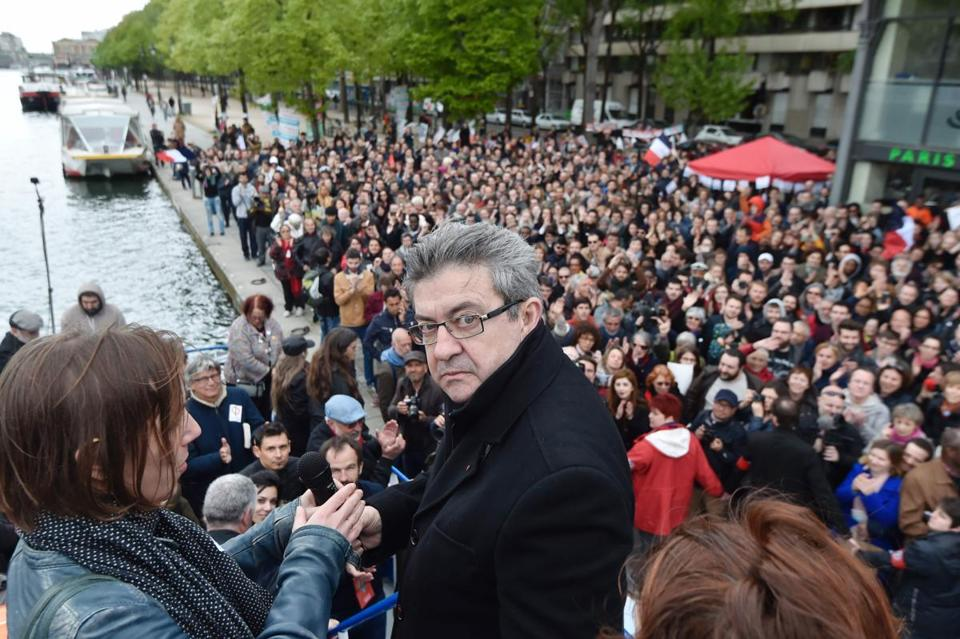 French presidential candidate Jean-Luc Melenchon stood aboard a barge Monday as he prepared to campaign along the canals of Paris.