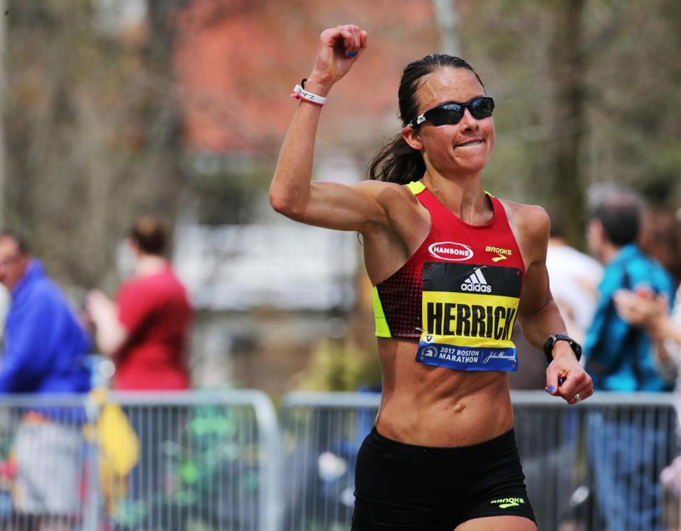 Dana Herrick celebrated as she crestiedHeartbreak Hill on Commonwealth Avenue in Newton.