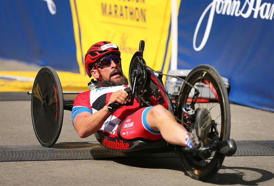 Boston-04/17/2017- The Boston Marathon finish line- Winner of the handcycle, Tom Davis from NYC crosses the fiinish line. John Tlumacki/Globe staff(sports)