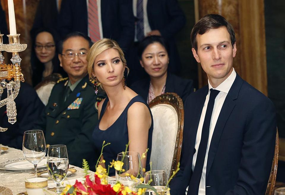 FILE - In this Thursday, April 6, 2017, file photo, Ivanka Trump, second from right, the daughter and assistant to President Donald Trump, is seated with her husband, White House senior adviser Jared Kushner, right, during a dinner with President Donald Trump and Chinese President Xi Jinping at Mar-a-Lago in Palm Beach, Fla. Earlier in the day, Ivanka Trump's company received provisional approval from the Chinese government for three new trademarks, winning monopoly rights to sell Ivanka brand jewelry, bags and spa services in the world's second-largest economy. (AP Photo/Alex Brandon, File)