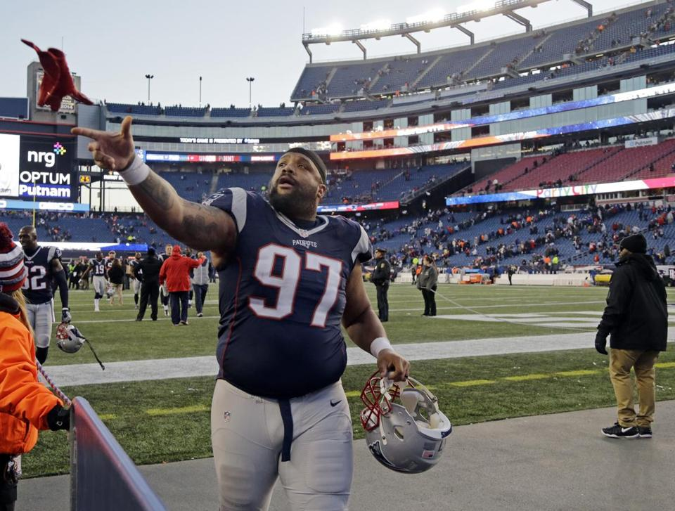 New England Patriots defensive lineman Alan Branch (97) tosses his gloves to a fan after their 26-10 victory over the Los Angeles Rams in an NFL football game, Sunday, Dec. 4, 2016, in Foxborough, Mass. (AP Photo/Elise Amendola)