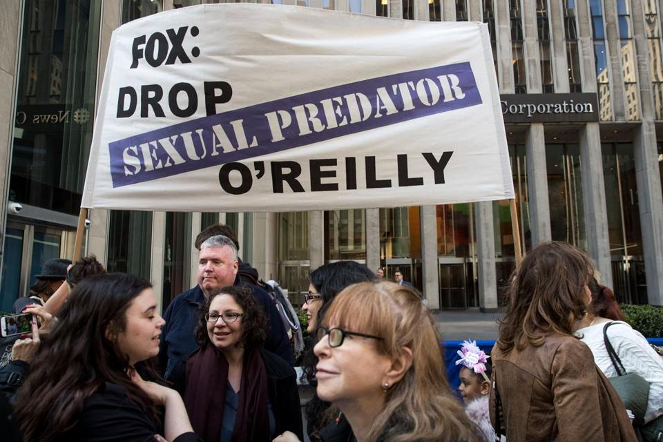 NEW YORK, NY - APRIL 18: Demonstrators rally against Fox News television personality Bill O'Reilly outside of the News Corp. and Fox News headquarters in Midtown Manhattan, April 18, 2017 in New York City. The protest against O'Reilly, who has been the subject of numerous sexual harassment allegations and legal settlements, was organized by the women's group UltraViolet and the New York chapter of National Organization for Women. (Photo by Drew Angerer/Getty Images)