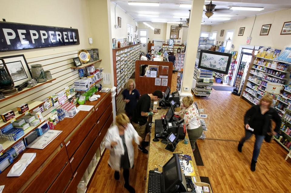 Customers and staff moved about in the Pepperell Family Pharmacy.