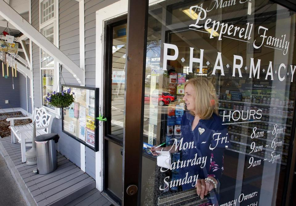 Judy Shattuck carried a prescription to the parking lot for a customer at the Pepperell Family Pharmacy in Pepperell last month.