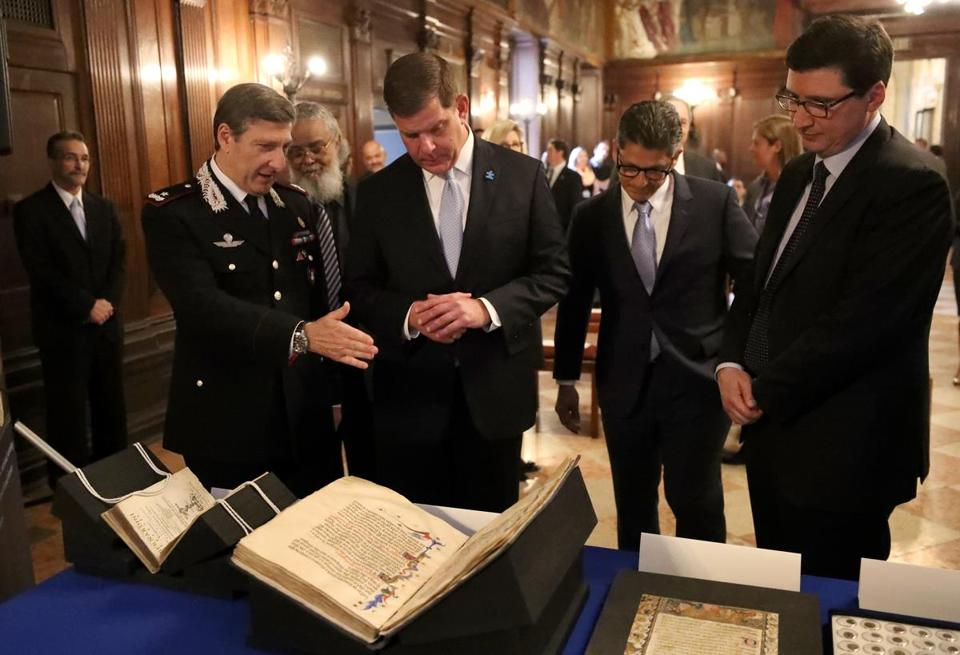 BOSTON, MA - 4/19/2017: A repatriation ceremony with L-R Brigadier General Fabrizio Parrulli, Carabinieri Commander for the Protection of Cultural Heritage, Mayor Martin J. Walsh, Matthew Etre, Special Agent in Charge at DHS-ICE Homeland Security Investigations and Nicola De Santis Consul General of Italy Boston. Public Library will formally return three artifacts previously part of its Special Collections to Italy. The items include Mariegola della Scuola di Santa Maria della Misericordia, a medieval manuscript dating to 1392, an illuminated leaf from the manuscript Scuola Grande di San Giovanni Evangelista, dating from between 1418-1422, and Varii de natvralibvs rebvs libelli, a collection of works by Bernardino Telesio, published in 1590. ( David L Ryan/Globe Staff Photo) SECTION: METRO TOPIC 20artifacts
