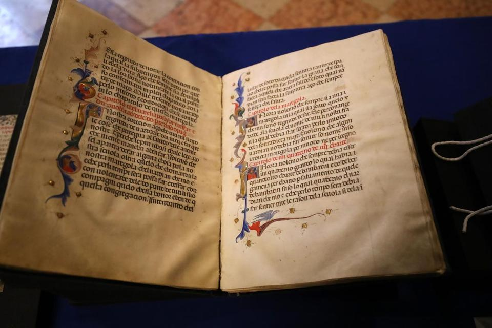 BOSTON, MA - 4/19/2017: A repatriation ceremony at the Boston Public Library will formally return three artifacts previously part of its Special Collections to Italy. One of the items included the Mariegola from the Scuola di Santa Maria di Valverde della Misericordia, a medieval manuscript dating to 1392, ( David L Ryan/Globe Staff Photo) SECTION: METRO TOPIC 20artifacts