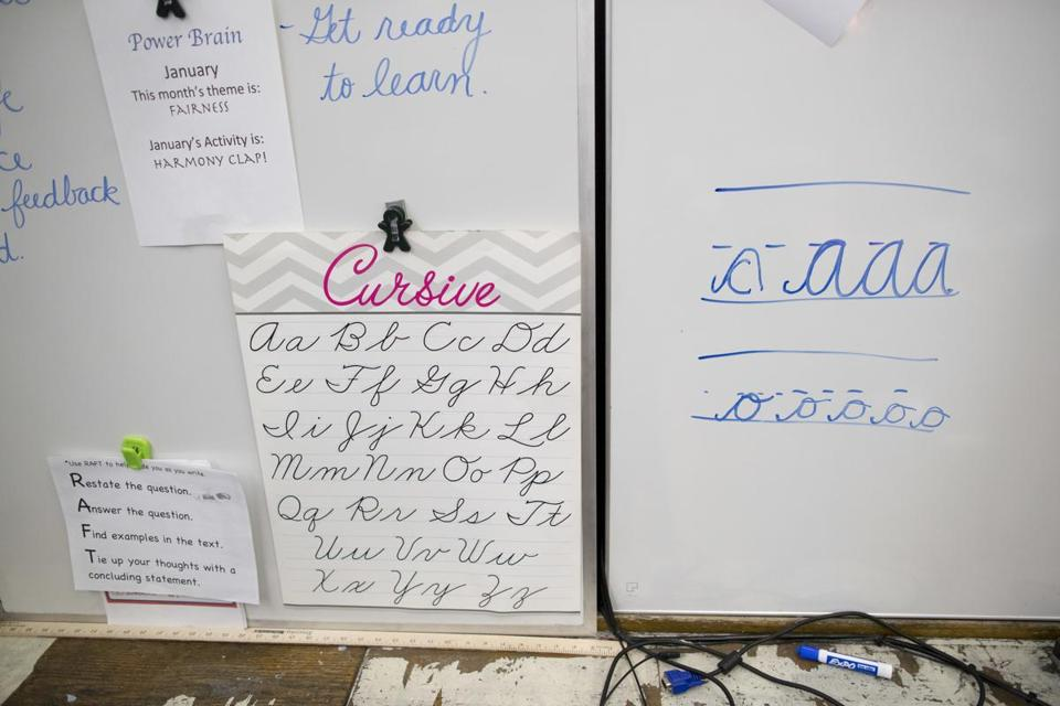 In this Wednesday, March 1, 2017, photo, a sample of cursive letters are on display in the third-grade classroom at P.S. 166 in the Queens borough of New York. Schools Chancellor Carmen Farina distributed a handbook on teaching cursive writing in September and is encouraging principals to use it. (AP Photo/Mary Altaffer)