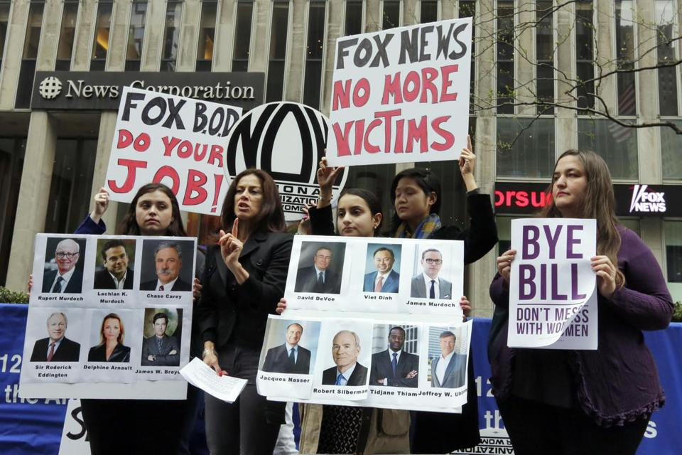 Sonia Ossorio, second left, president of the National Organization for Women New York, speaks outside the News Corporation headquarters, in New York, Thursday, April 20, 2017, a day after Fox News Channel's Bill O'Reilly was fired. The firing came on the heels of a New York Times report on April 1, that five women had been paid a total of $13 million to keep quiet about their disturbing encounters with O'Reilly. (AP Photo/Richard Drew)