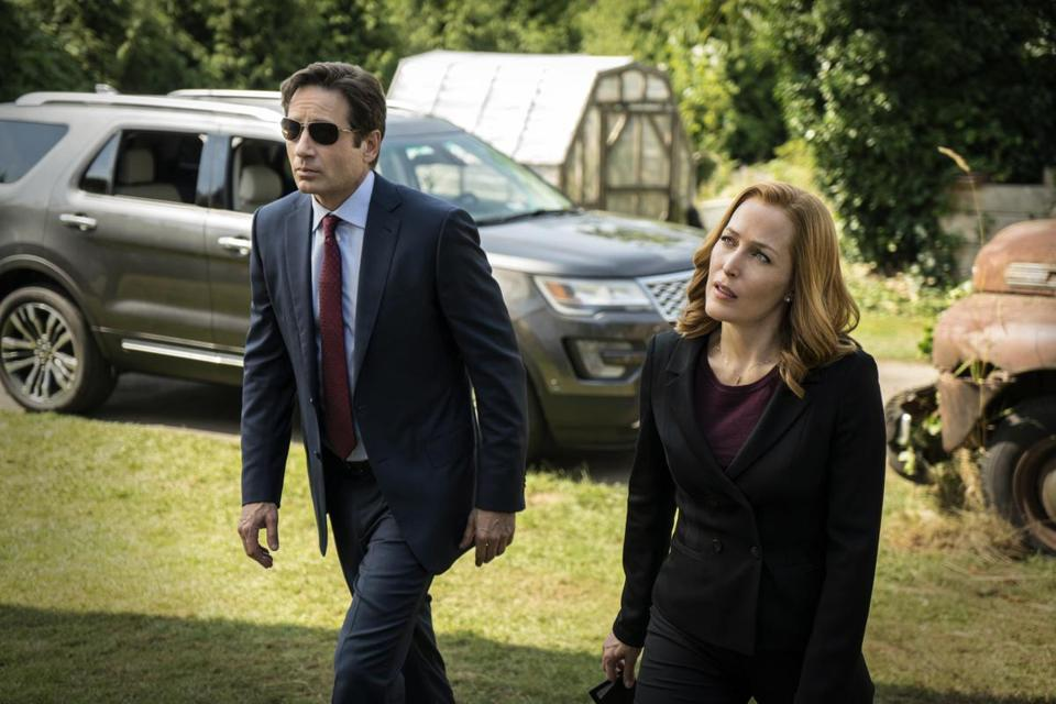 "This photo provided by FOX shows, David Duchovny, left, as Fox Mulder and Gillian Anderson as Dana Scully in an episode of ""The X-Files."" Fox said Thursday it has ordered a second chapter of what it's calling an ""X-Files"" ""event series."" The 10-episode series will air during the upcoming 2017-18 TV season. (Ed Araquel/FOX via AP)"
