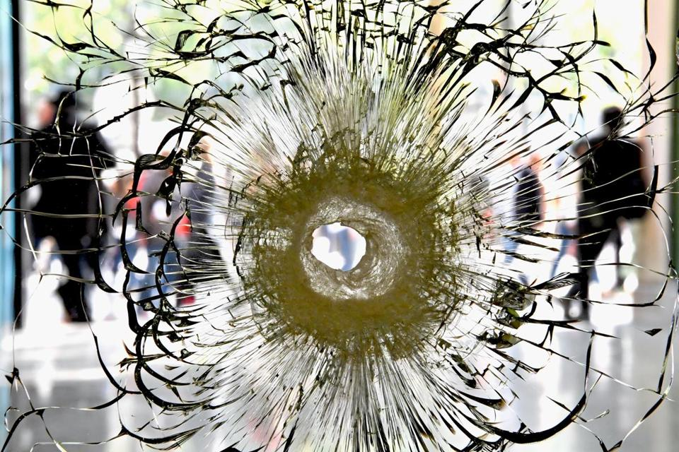 A bullet hole is seen in a window near to the Marks and Spencer on the Champs Elysees in Paris following Thursday's shooting of police officers.