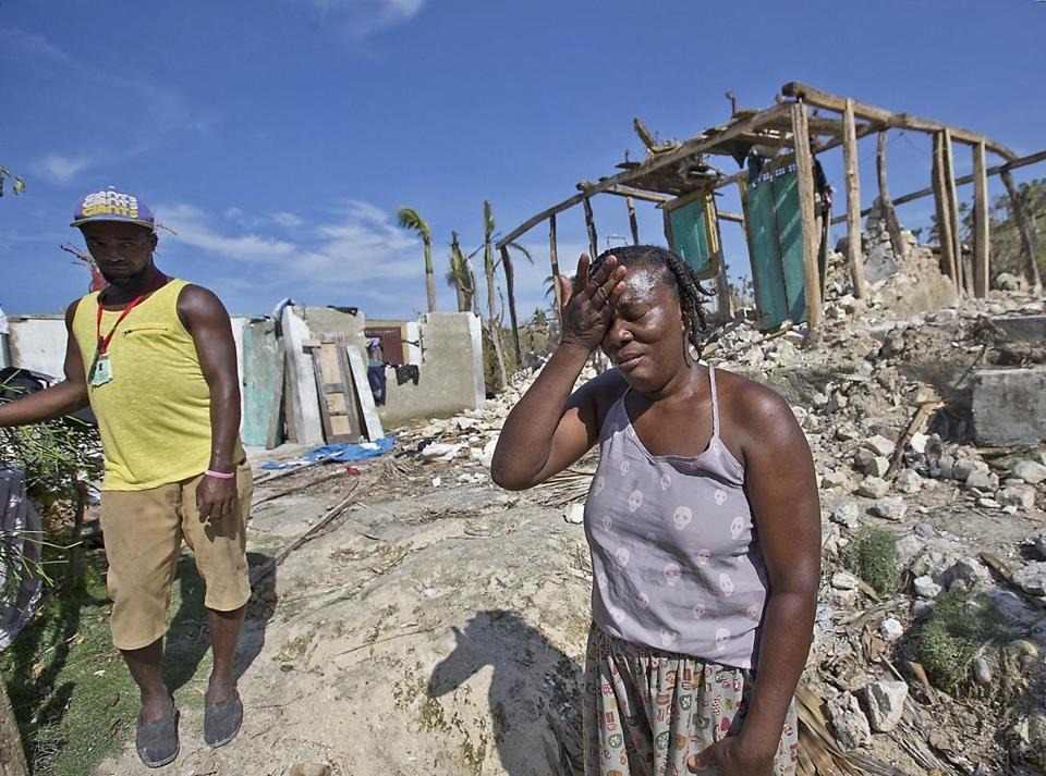Marie Louise Valentin wept in front of her destroyed home in October 2016 after Hurricane Matthew battered the island.