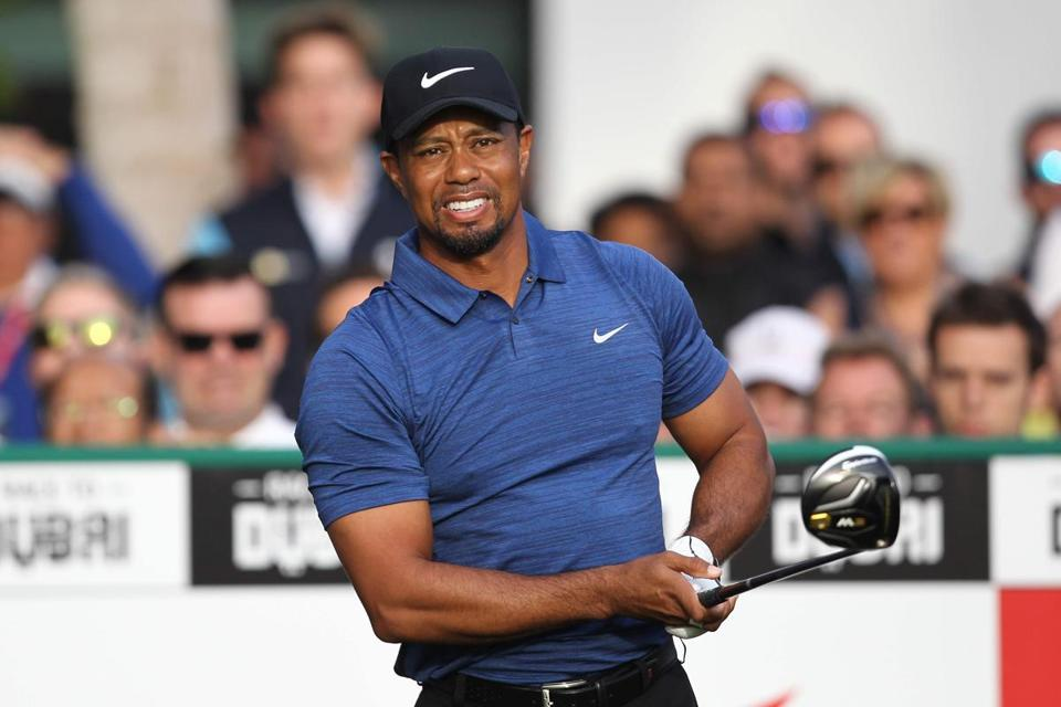 (FILES) This file photo taken on February 1, 2017 shows Tiger Woods of the United States playing a shot during the Dubai Desert Classic golf tournament at the Emirates Golf Club in Dubai. Woods announced on his website on April 20, 2017, that he has undergone a fourth back surgery to alleviate pain, one that likely sidelines him at least until October. / AFP PHOTO / NEZAR BALOUTNEZAR BALOUT/AFP/Getty Images
