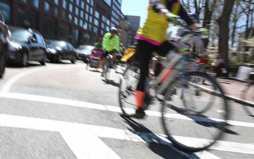 Boston, MA--4/23/2017 - Riders zip from Boylston to Charles Street. An organizer of the Make Way for Bike Lanes ride around the Boston Public Garden said at least 250 showed up for the ride. This was to call attention to the need for safer streets around the area landmarks. Photo by Pat Greenhouse/Globe Staff Topic: 24bikes Reporter: XXX