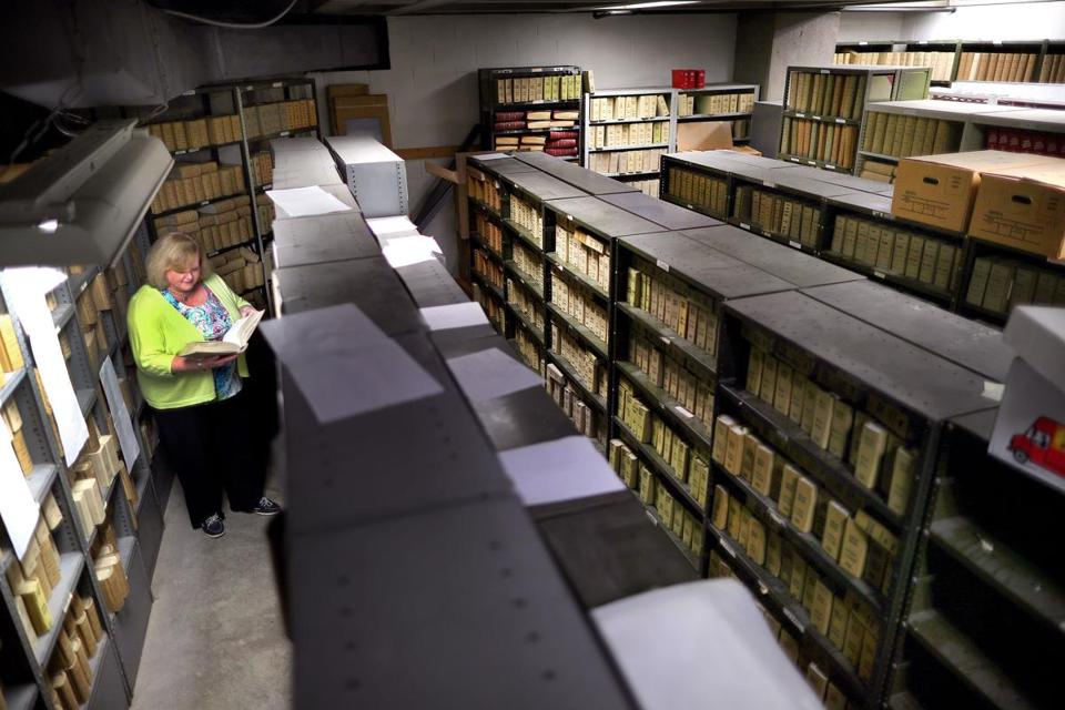"Patricia A. McMahon scoured through birth certificate books dating from the 1950s. The books are stored in the ""dungeon,"" as she calls it, in the bowels of Boston City Hall."
