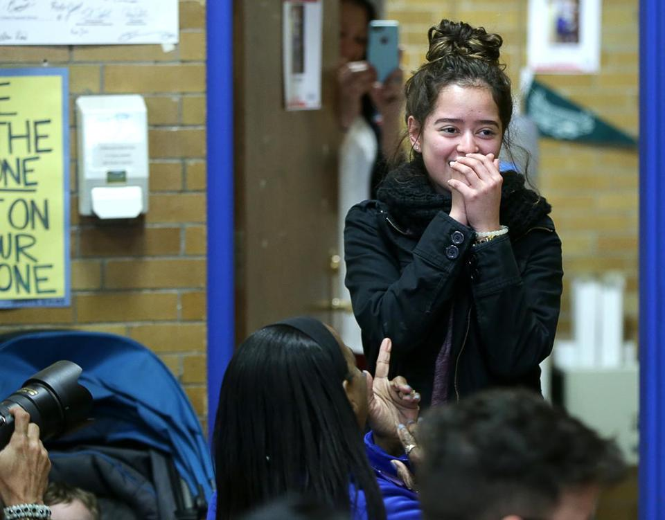 East Boston MA 04/25/2017 Yesica Calderon (cq) reacts to a room full of friends and family inside the school's library . In a surprise annoucement to all who were gathered, Yesica, won a full academic scholarship to Regis College. GlobeStaff) Reporter:Topic