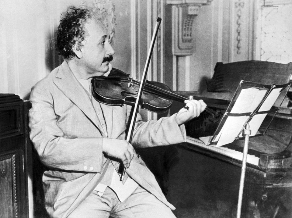 (FILES) Picture taken in Princeton in 1931 of German-born Swiss-US physicist Albert Einstein (1879-1955), author of theory of relativity, awarded the Nobel Prize for Physics in 1921, playing the violin. Germany, the birthplace of Albert Einstein, launches 19 January 2005 a year of international celebrations to mark the 100th anniversary of three of the physicist's four papers that changed the way we view the Universe. AFP PHOTO/FILES (Photo credit should read -/AFP/Getty Images) Published in NYTimes 03/01/05 SCIENCE SECTION Published caption: A Century of Einstein: 1931. Library Tag 03152005 Health/Science