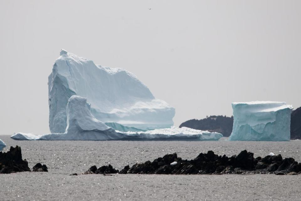 A large iceberg that broke off of Greenland floated in the Atlantic off the coast of Newfoundland, Canada, on Wednesday.