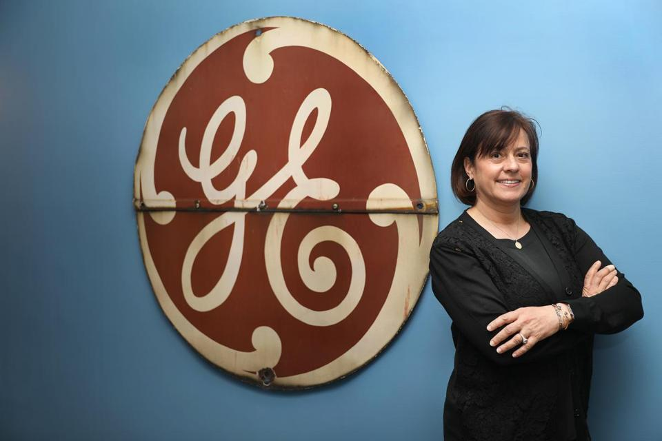 "Boston, MA--4/20/2017 - Ann R. Klee (cq) -- ( GE vice president of Boston Development and Operations) She is photographed at the temporary headquarters in Boston, with the company's ""meatball."" The vintage 1920's GE monogram is from the Bridgeport, CT plant. Photo by Pat Greenhouse/Globe Staff Topic: 051417klee Reporter: Shirley Leung"