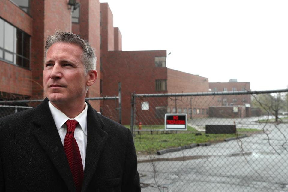 April 26, 2017-- MALDEN - Malden City Councilor John Matheson, (ward 3) outside the site of the Malden Hospital which closed 17 years ago. The city of Malden recently lost a lawsuit again Hallmark Health, which owns the vacant property, in an attempt to make Hallmark perform extensive fire safety repairs inside the building, a 330,000-square-foot structure. (globe staff photo: Joanne Rathe topic: 07nomalden section: north weekly now)