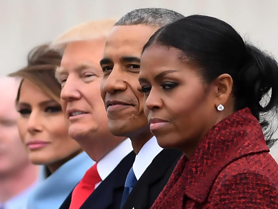"(FILES) L-R: First Lady Melania Trump, President Donald Trump,former President Barack Obama, Michelle Obama at the US Capitol after inauguration ceremonies at the in Washington, DC, on January 20, 2017. While the new US president has shown a capacity to change, both his tone and his positions, he has been unable to show the world a ""new"" Trump, with a steady presidential style and a clearly articulated worldview. As the symbolic milestone of his 100th day in power, which falls on April 29, 2017, draws near, a cold, hard reality is setting in for the billionaire businessman who promised Americans he would ""win, win, win"" for them. At this stage of his presidency, he is the least popular US leader in modern history (even if his core supporters are still totally behind him.) / AFP PHOTO / JIM WATSON / TO GO WITH AFP STORY, US-politics-Trump-100days JIM WATSON/AFP/Getty Images"