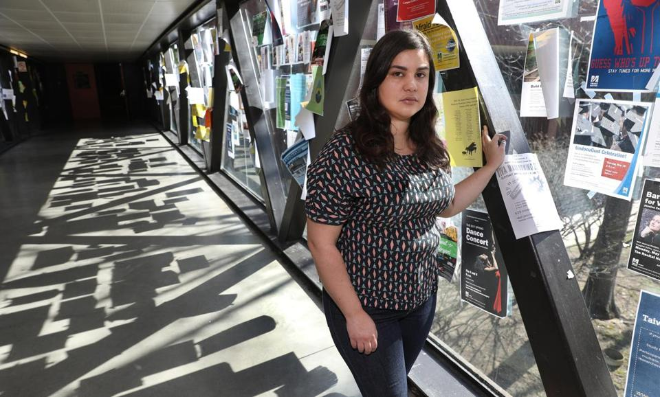 Boston, MA--4/11/2017 - Renata Teodoro (cq), an undocumented student activist at UMass Boston, stands on the catwalk between the Science Center and John W. McCormack Hall. Among the many posted flyers are ones for the upcoming UndocuGrad Celebration for the 2017 graduating DACA students. She is the contact person for the Student Immigrant Movement and works with the Office of Diversity and Inclusion. She is photographed for the Game Changers project. Photo by Pat Greenhouse/Globe Staff Topic: 051417renata Reporter: Deirdre Fernandes