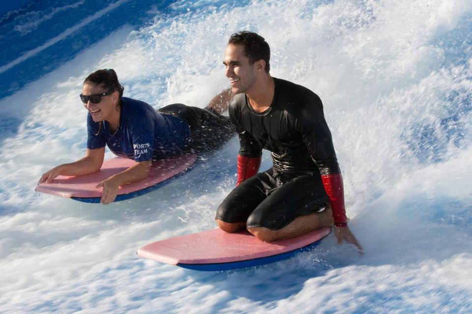 "Catching ""waves"" on the ship's FlowRider surfing  simulator."