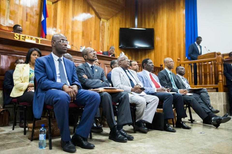 Membres of the new government appointed by Prime minister, Jack Guy Lafontant sit during a parliamentary session to confirm them in Port-au-Prince on March 15, 2017. The Haitian premier has chosen mostly political novices for the country's new government, nearly three weeks after President Jovenel Moise appointed him to the post.Jack Guy Lafontant, a doctor who like Moise is new to the political scene, signed a decree Monday nominating of his 18 ministers, five of whom are women. / AFP PHOTO / Valerie BaeriswylVALERIE BAERISWYL/AFP/Getty Images