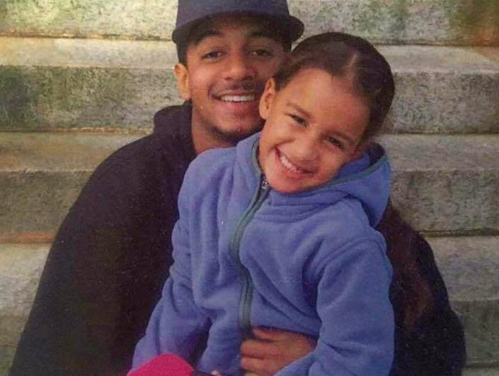 Aaron Brito with his daughter.