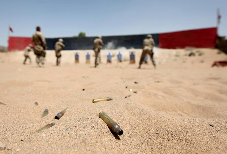 Cartridges lie in the sands as Canadian Task Force Kandahar soldiers take part in a shooting exercise at Camp Nathan Smith in Kandahar city on June 7, 2010. NATO, US and Afghan troops are preparing their biggest offensive against the rebels in the southern province of Kandahar, with foreign troop numbers set to peak at 150,000 by August. AFP PHOTO / ED JONES (Photo credit should read Ed Jones/AFP/Getty Images)