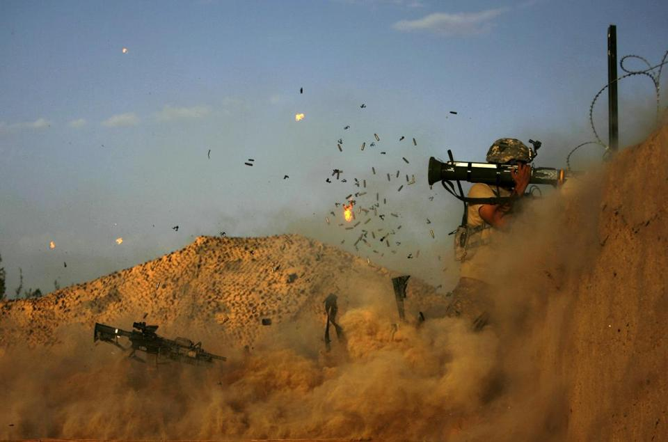 A US army soldier with the 101st Airborne Division Alpha Battery 1-320th fires an AT-4 as Combat Outpost Nolen on the outskirts of the village of Jellawar in the Arghandab Valley came under Taliban attack on September 11, 2010. The United States and NATO have 150,000 troops in Afghanistan fighting the Taliban-led insurgency, most of them in the southern hotspots of Helmand and Kandahar provinces.AFP PHOTO/PATRICK BAZ (Photo credit should read PATRICK BAZ/AFP/Getty Images)