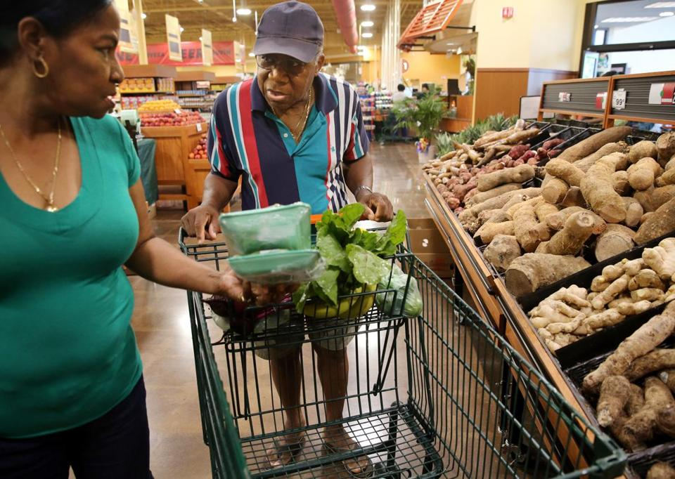 Shoppers walked through the aisles of Vincente's Supermarket in Brockton in 2015. Brockton is one of the state's cities with the biggest grocery access problems.