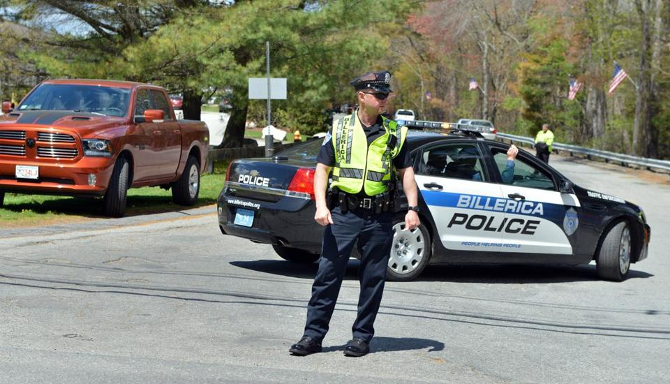 Police block the entrance to the Greater Boston Auto Auction, where least two people were killed Wednesday when an SUV apparently careened through a large auto auction facility in Billerica. Josh Reynolds for The Boston Globe (Metro, desk)