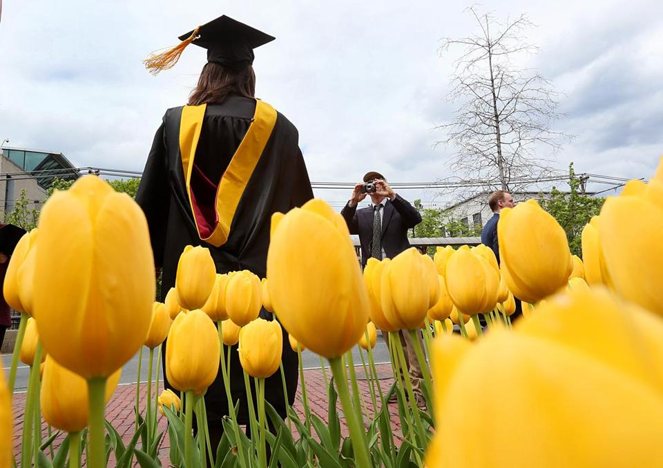 Boston, MA., 05/03/17, At Northeastern University, Ann Farr, cq, gets photographed in front of blooming tulips as she celebrates her graduation and her Masters degree in Science and Nursing. Globe staff/Suzanne Kreiter