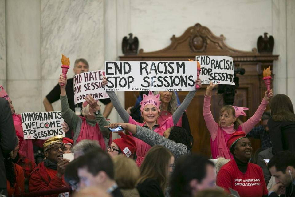Women affiliated with Code Pink protesed during a confirmation hearing for Sen. Jeff Sessions on Capitol Hill in January. Desiree Fairooz, at center behind sign, was convicted of disorderly conduct and demonstrating on Capitol grounds.