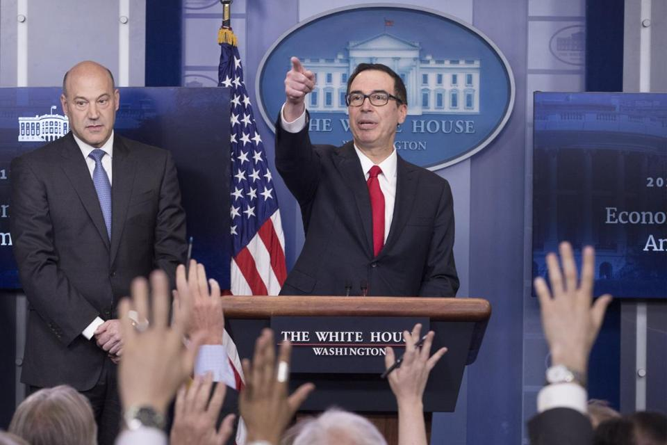 epa05929377 US Treasury Secretary Steven Mnuchin (R) and National Economic Director Gary Cohn (L) participate in a news conference to discuss the tax reform plan of US President Donald J. Trump, in the James Brady Press Briefing Room at the White House in Washington, DC, USA, 26 April 2017. EPA/MICHAEL REYNOLDS