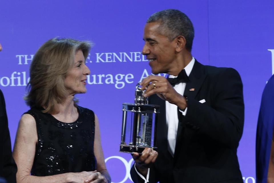 Obama received the award from Caroline Kennedy.