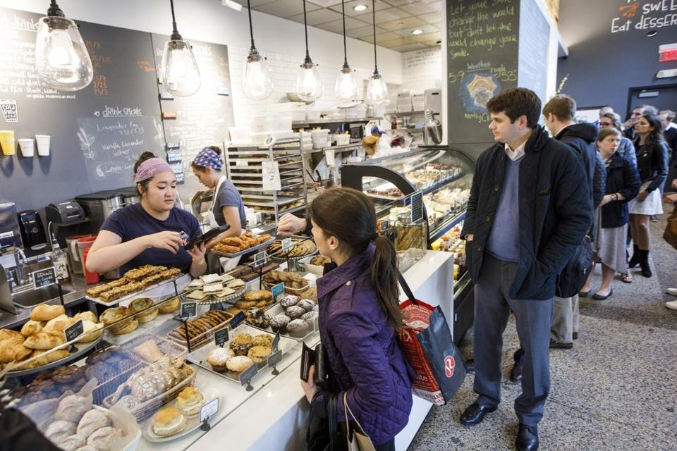 Boston, MA - 5/9/2017 - Customers wait in line for lunch orders bought in store at Flour Bakery in Cambridge, MA, May 9, 2017. (Keith Bedford/Globe Staff)