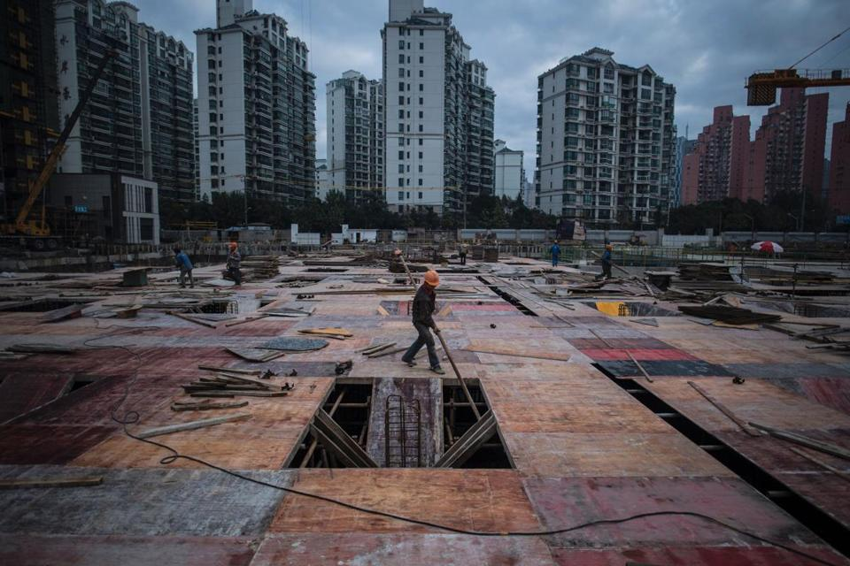 A man worked at a construction site of a residential skyscraper in Shanghai in November.
