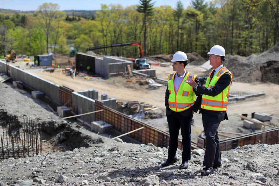 King Street Properties is working on a $200 million biomedical complex in Cambridge that doesn't yet have tenants. Developers Tyson Reynoso (above left) and Stephen Lynch looked out over the work.
