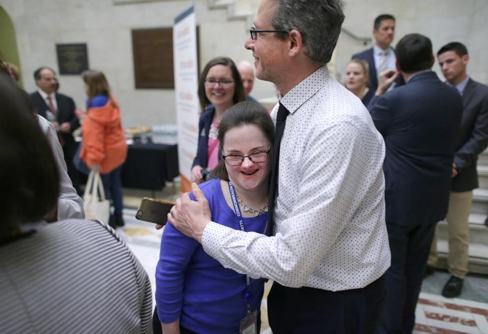 05/10/2017 Boston Ma Melissa Reilly (cq) left and Josh Komyerov (cq) right , Operations Director for the Massachusetts Down Syndrome Congress, were a afternoon press-conference where the Governor announced the opening of Attainable, the Massachusetts ABLE savings plan created for individuals with disabilities to save for disability related expenses . Boston Globe Staff\Photograph Jonathan Wiggs Reporter:Topic