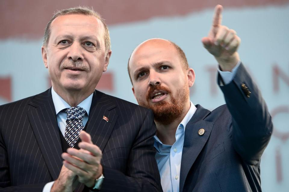 "Turkish President Tayyip Erdogan (L) and his son Bilal Erdogan (R) stay on the stage during Istanbul Youth Festival in Istanbul on May 4, 2017. Turkish President Recep Tayyip Erdogan said a Moscow-backed plan to set up so-called de-escalation zones inside Syria would ""50 percent"" solve the six-year conflict, in comments published Thursday. / AFP PHOTO / OZAN KOSEOZAN KOSE/AFP/Getty Images"