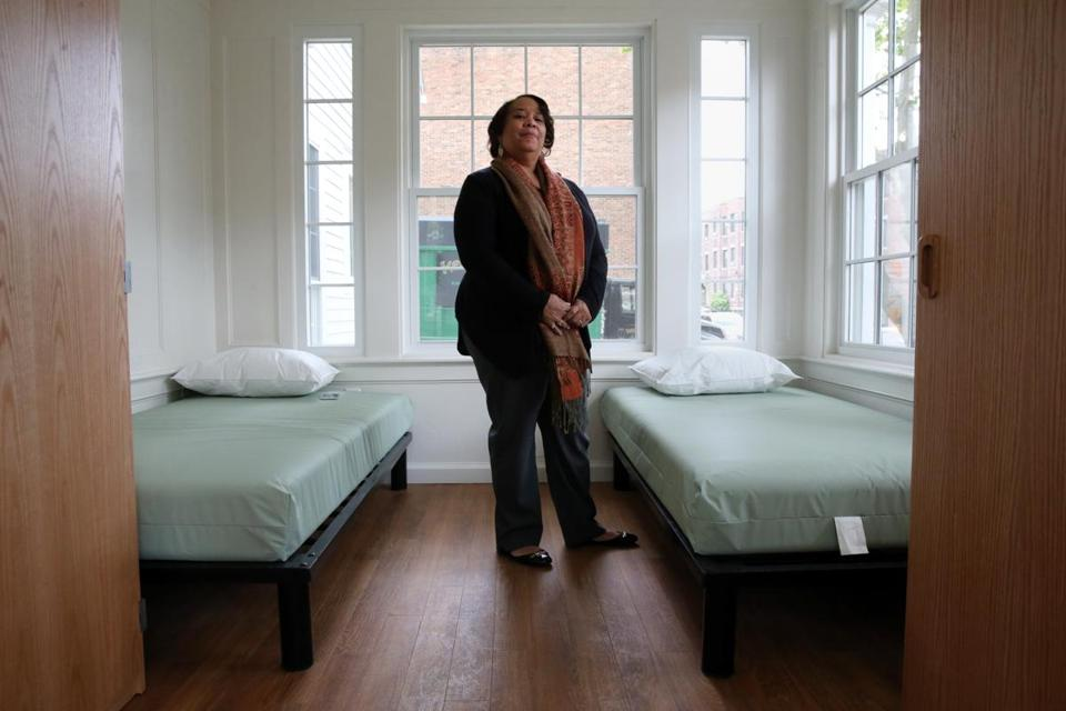 Program director Henryce Jackson-Gumes posed in a room at New Joelyn's Home in Boston.