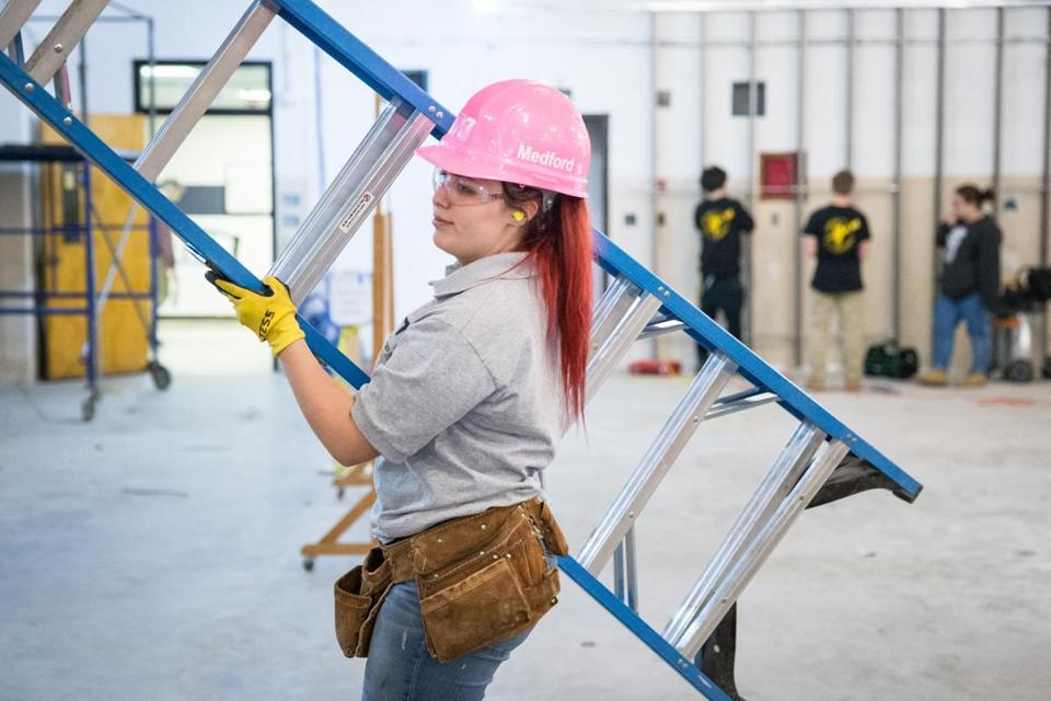 05/08/2017 MEDFORD, MA Tess Mauro (cq) 17, helps build the framework for a restaurant at Medford Vocational Technical High School. (Aram Boghosian for The Boston Globe)
