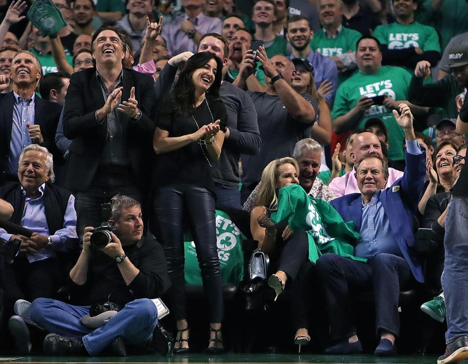 Boston, MA May 10, 2017: Patriots head coach Bill Belichick (right) was enjoying himself as he acknowledges the applause when he is shown on the scorebaord in the fourth. Celtic owner Wyc Grousbeck and Patriots owner Robert Kraft are at left. The Boston Celtics hosted the Washington Wizards in Game Five of their NBA Eastern Conference semi final playoff series at the TD Garden. (Globe Staff Photo/Jim Davis)